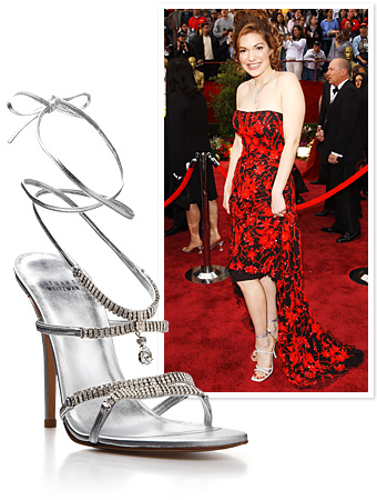 "Stuart Weitzman's Million Dollar Shoe first made its debut at the 2002 Academy Awards on ""Mulholland Drive"" star Laura Harring. It was adorned with 464 diamonds, designed to be removable so they can be worn as jewelry. It fetched a price tag of USD $1.09 million"