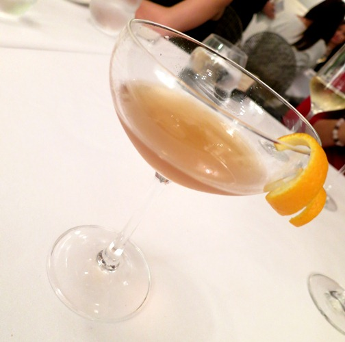 Dinner begins with a welcome drink of vermouth rouge served with orange peel
