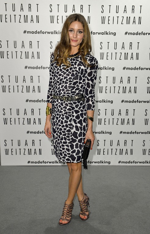 Olivia Palermo in Stuart Weitzman merlot snakeskin LOOPS booties (Photo courtesy of Stuart Weitzman)