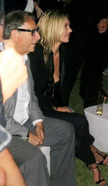 "Stuart Weitzman and Kate Moss watching the ""Made for Walking"" video. Kate clapped her hands and cheered as she watched herself on screen"