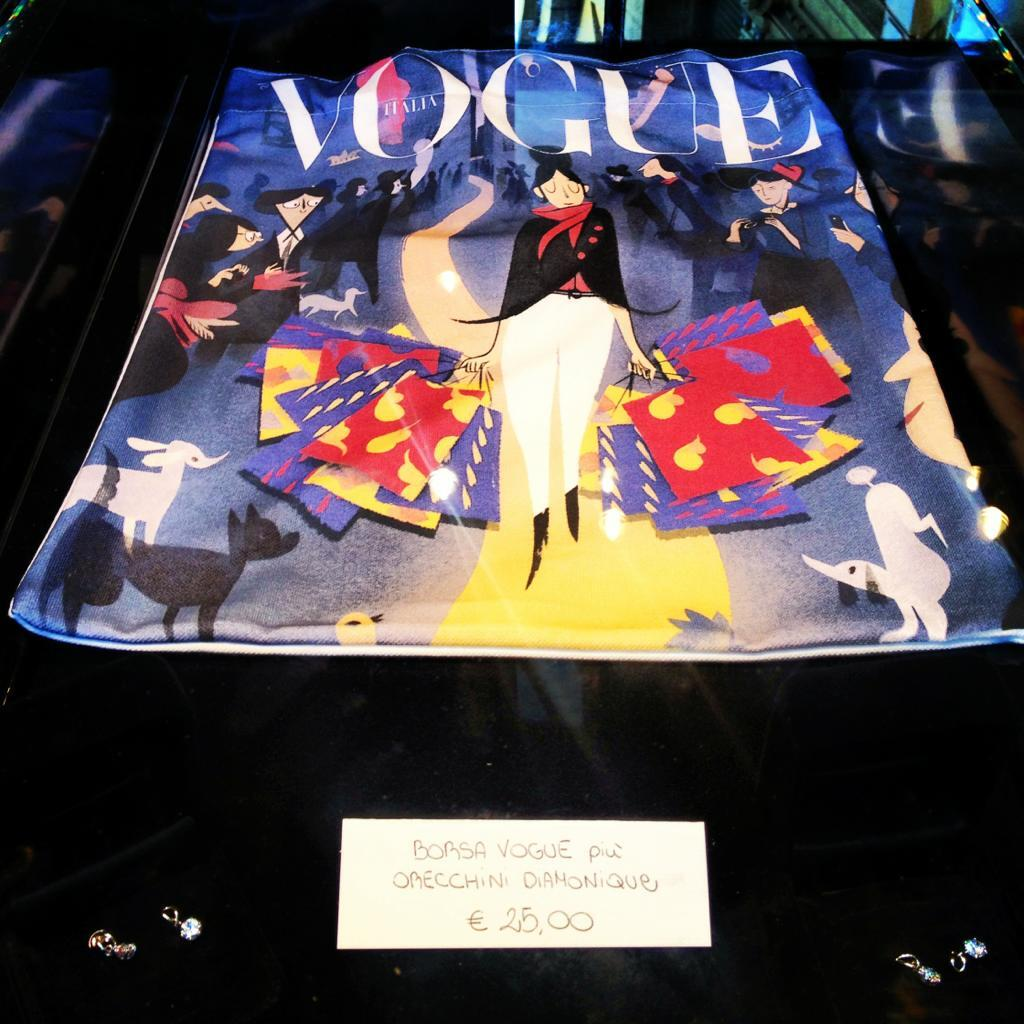 This adorable Vogue Italia tote bag comes free with a purchase of 25 euro earrings from Diamonique during Milan Fashion Week
