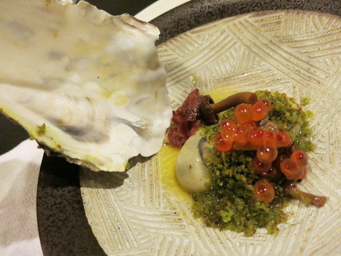 Oyster poached in butter and sake, pickled mushrooms, and ikura marinated in sake.. with  breadcrumbs made from seaweed salt and lemon grass