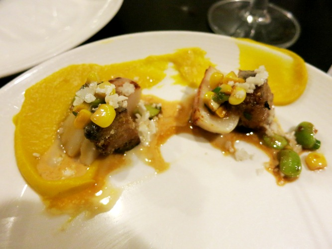 Scallops with dried adductor scallops turned into XO sauce and thickened with a bit of uni and lemon grass. The white specks are cauliflower and chopped eggs
