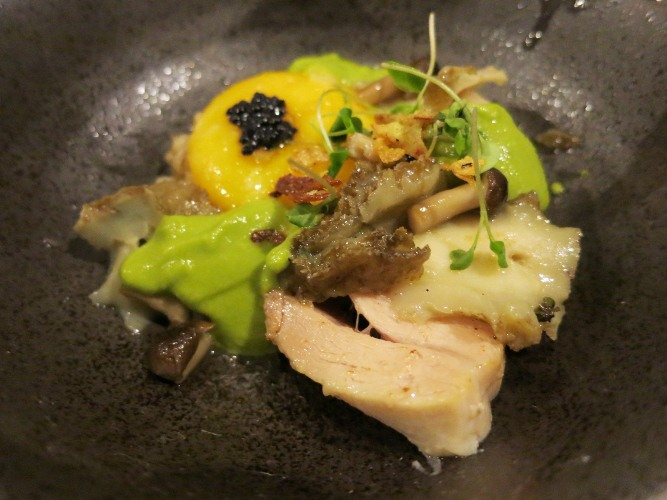 Tuna belly poached in olive oil. paired with barley; egg yolks and sauce made from asparagus, mushroom and abalone, topped with lumpfish caviar and rock salt