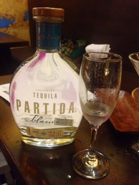 A shot of Partida Blanco (P450) is served in a long-stemmed glass. According to Aljor, this is how they drink tequila in Mexico