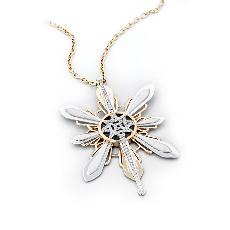 Three Stars and a Sun diamond pendant, 1.02 total carat weight, set in white and yellow gold