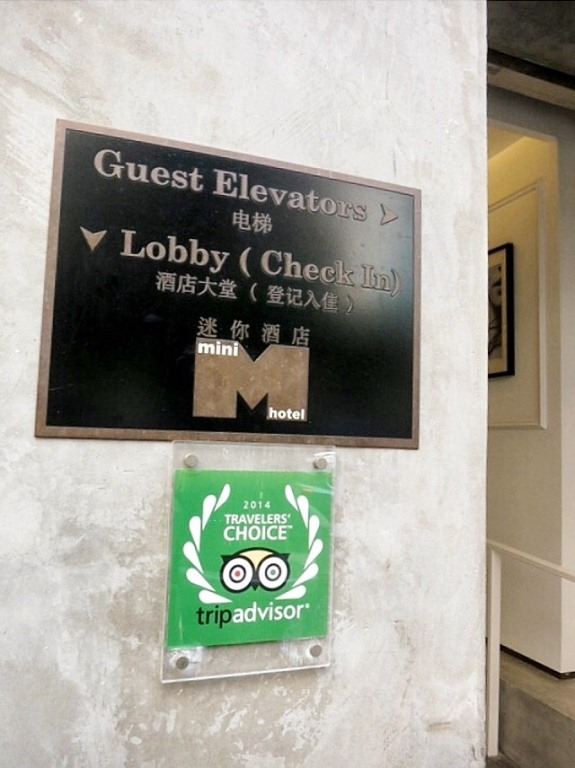 The hotel has been named TripAdvisor's 2014 Travelers' Choice. The lobby and check-in/ reception is at the basement to the left, while the guest elevators are to the right.