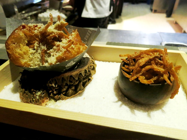 The bread course comes in the form of a tocino and onion bun with shaved durian, onion rings and chicken liver ice cream