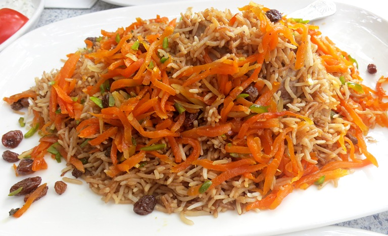 My most memorable meal in London was at an Afghan restaurant called Ariana at Mile End neighborhood. This is the Qabili Pulao or Kabuli Palaw, a traditional Afghan pilaf dish that's usually a complete meal in itself. It's steamed long-grained rice cooked in lamb-shank juices — that come from three hours of boiling — mixed with fried carrots, raisins, almonds and pistachios. When served, the lamb was buried in the middle of the dish, but unearthing it from the pile of rice revealed the most tender meat that fell gracefully even with just the nudge of a fork. It complemented the sweetness brought by the raisins, and was just — to put it simply — really, really good.