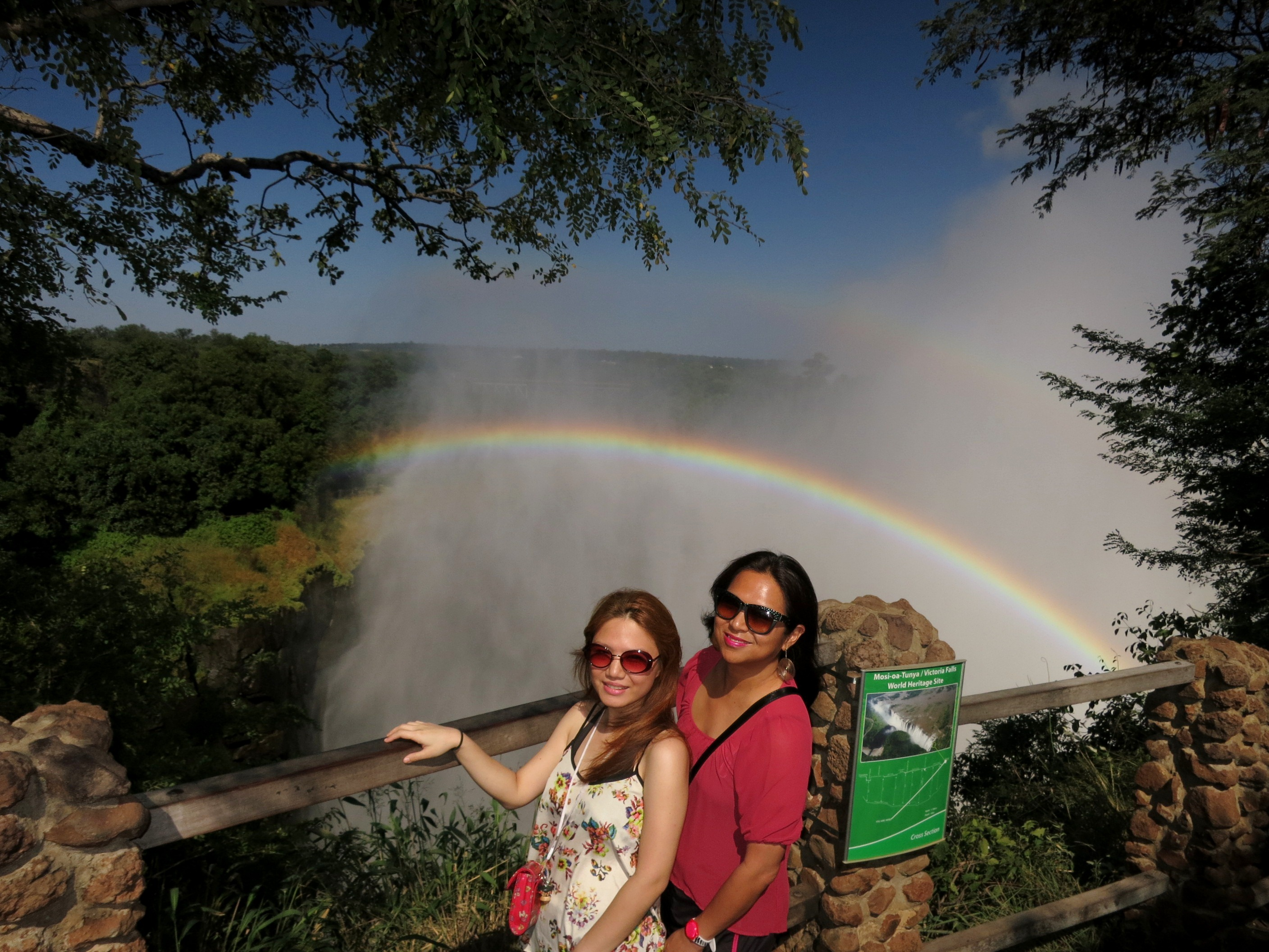 This photo of myself with one of my favorite travel buddies Christine Dayrit is absolutely precious because you can see the DOUBLE rainbow at Victoria Falls. Truly God's marvelousness.