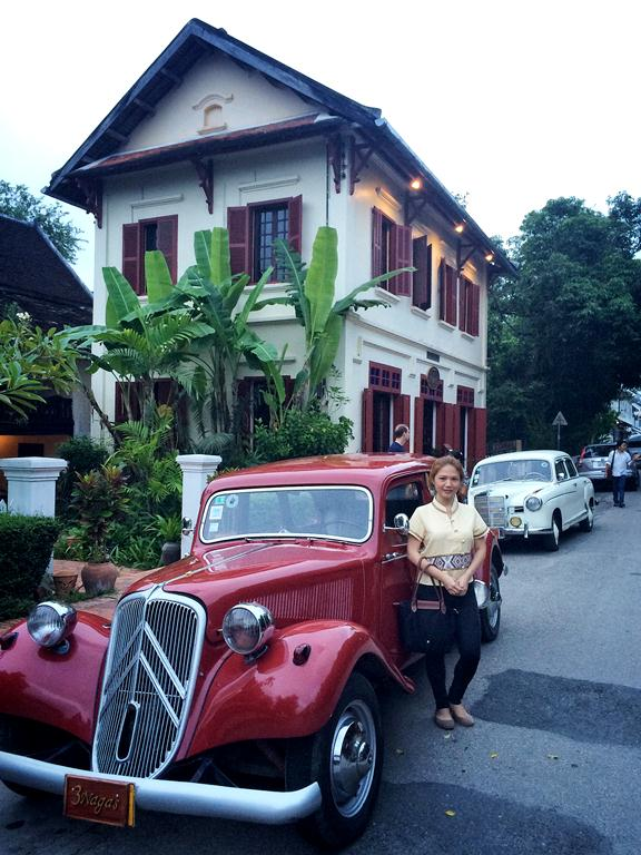 I bought a Laotian top so I could align with the colonial architecture of Luang Prabang-- with a stunning vintage car at that!