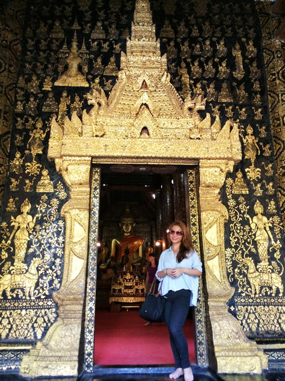 Me by the gorgeous ornate entrance of Wat Xieng Thong, which is also known as the Temple of the Golden City. You have to take off your shoes before entering.