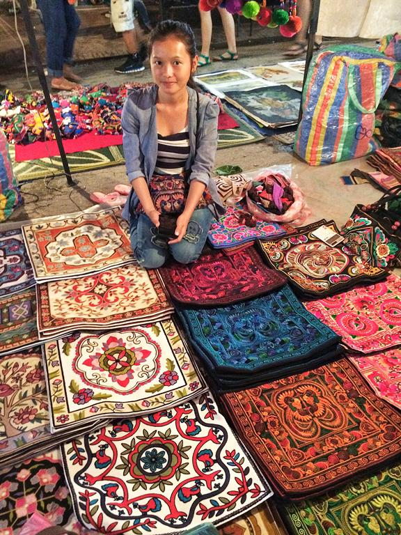 Gorgeous pillowcases handmade by this young Laoatian vendor at the street market at Sisavang Vong Road