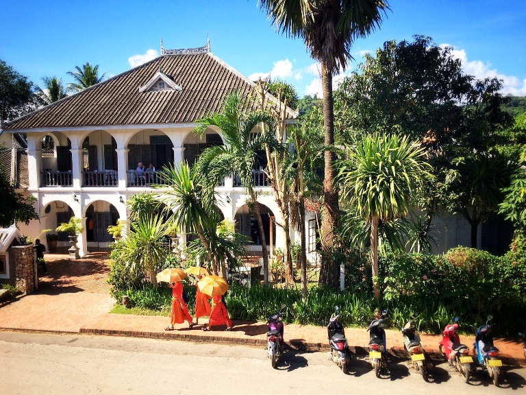 This is Luang Prabang in a snapshop= colonial architecture (of Villa Santi) + motorbikes + Buddhist monks.