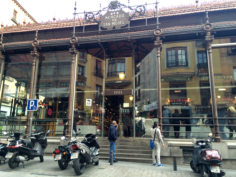 The popular Mercado San Miguel is one of the stops at Madrid Food Tour. Did you know that it used to be an illegal fish market in the 1900s?  What it is today is the idea of 4 friends who  bought it and converted it into a hygienic food market where the stalls were run by Spaniards