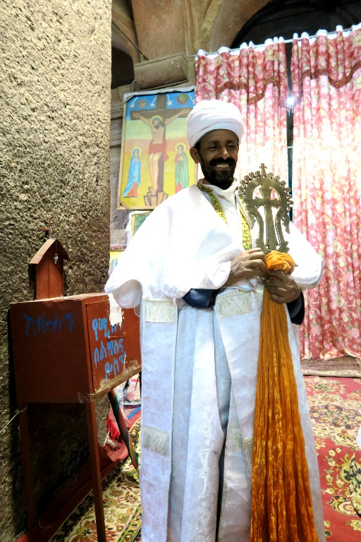 In Ethiopian Orthodox, priests are allowed to get married but they remain as priests. The celibate ones are the ones who are allowed to go up in rank/ hierarchy, as bishops, etc. The healing cross is only present on Sundays, and we were lucky to have been blessed by several of them.
