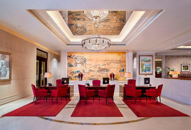 "The quiet elegance of St. Regis Singapore begins at the lobby, where upon checking in, you are fronted with the famous ""A Gathering of Immortals from the mid-19th century. (Photo courtesy of St. Regis Singapore)"