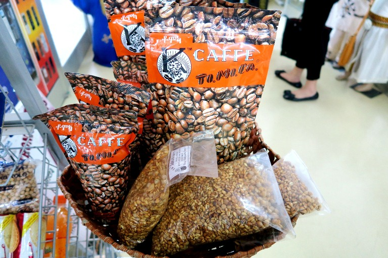 Tomoca Coffee is everywhere from the Tomoca cafes to supermarkets to the airport! Here in the photo with it is kola, which is a popular Ethiopian snack made from roasted barley