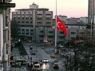 The flag of Turkey on Taksim Square flying half-mast (half-staff) the day after the twin suicide bombings as a sign of mourning