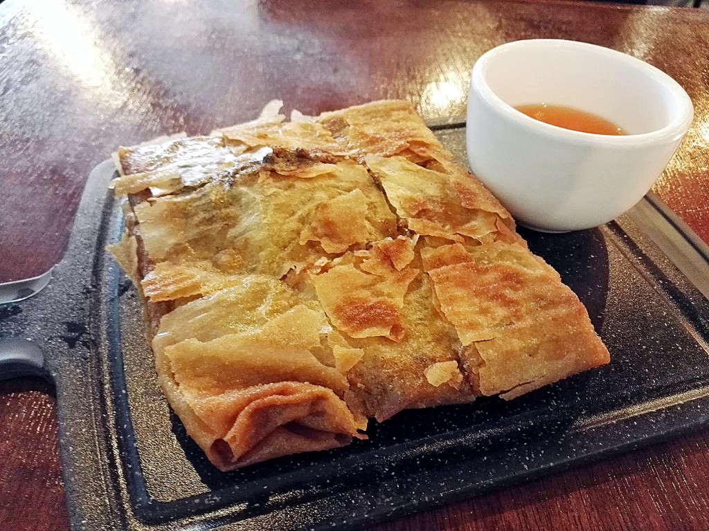 This beef martabak (savory pancake) is da bomb! Pan-fried to a crisp, alright. IT takes 15-20 minutes to prepare so order ahead. They also have a chicken filling.