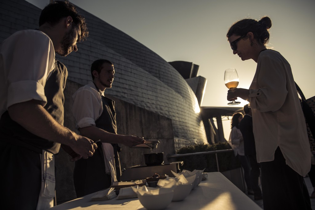 French journalist Camille Labro (Le Monde/ M Magazine World/ Vogue Paris) surveys the snacks served at the rooftop. (Photo by Miguel Toña - MTVisuals)