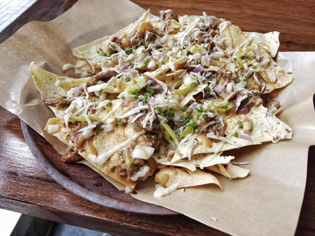 Papadum (Indian Tortilla) Nachos topped with sisig (PHP180)