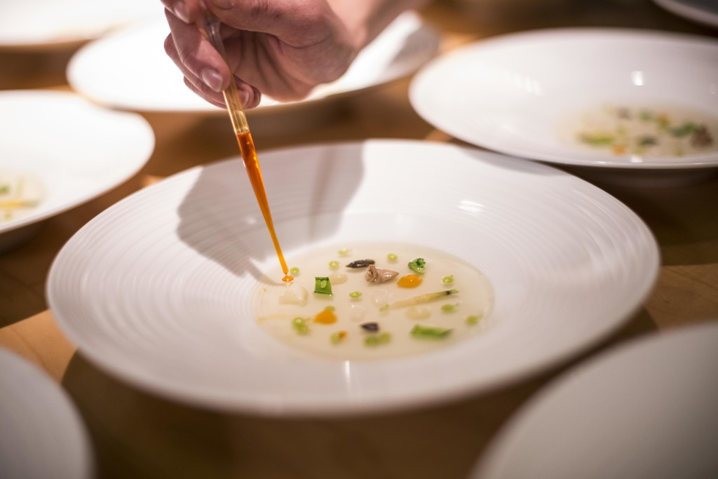 A beautiful start: Spring vegetable stock with vegetable emulsion, carrots, baby broad beans, flat beans, flowers and leaves by Joan Roca / El Celler de Can Roca (Photo by Miguel Toña - MTVisuals)