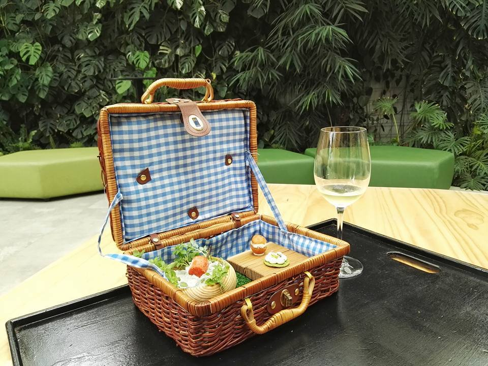 Welcome snacks at Azurmendi come in the form of their famous picnic basket and txakoli at their atrium (Photo by Cheryl Tiu)
