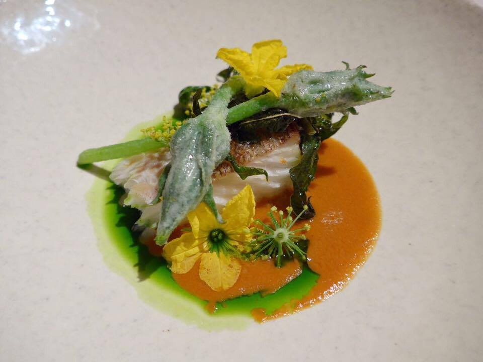 The first collaboration dish was between Hiroyasu Kawate (Florilege) and Gert de Mangeleer (Hertog Jan). It was cod - specifically a bycatch fish -with crab sauce and parsley oil and garnished with male zucchini flowers and fennel blossoms (parts that are normally thrown away). (Photo by Cheryl Tiu)