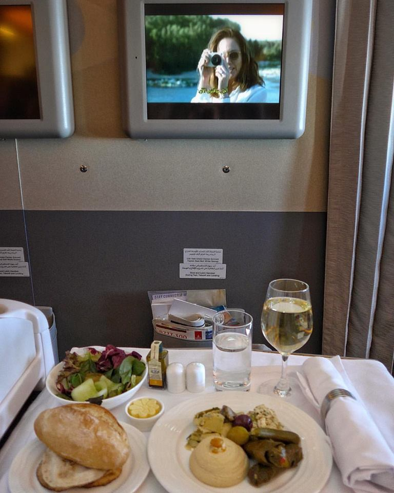 "I flew a Emirates from Manila- Dubai-Brussels and service was phenomenal. 👌👌👌 They are genuinely nice, attentive, remember everything about you (name, what you previously ordered so when you wake up, it's right there; they try to accommodate everyone regarding seat preferences; and when I asked for a particular drink and they had ran out, they were so apologetic, they offered to pour me a glass of Dom Perignon (!!!) from 1st class instead!! This was on my leg from Dubai to Brussels, eating Arabic mezze. Coincidenrally, this is my 1st photo using my new Leica C, and if you look at the screen, Diane Lane is also snapping with a Leica in ""Paris Can Wait""!-- which is such a great movie btw!"