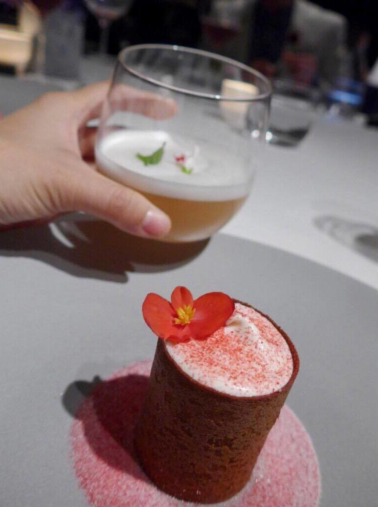 Dessert of raspberry, whipped cream with vanilla, roses, fresh cheese, and sour candy powder by Gert de Mangeleer paired with juice of rose and raspberry syrup (Photo by Cheryl Tiu)
