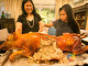 Our Phlippine lechon diva, Pepita's Kitchen, Dedet dela Fuente and daughter Liyora cutting their specialty lechon (Photo courtesy of Our Awesome Planet)