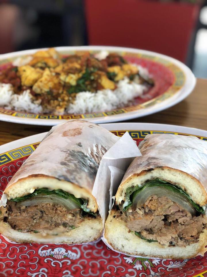 """One of the greatest things about South Florida is its proximity to the Caribbean.. hence amaaaazing """"Carribean-Latino"""" fare, like this Caribbean pork roast -- slow-cooked pork shoulder on lightly toasted baguette😍😍😍-- and mahi-mahi in spicy red sauce over jasmine rice-- at Bien, a self-service restaurant at a former gasoline station."""