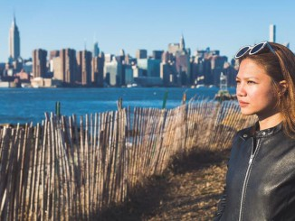 Contemplating life in Williamsburg, Brooklyn- overlooking the Manhattan skyline. (Photo by Jorsand Diaz)
