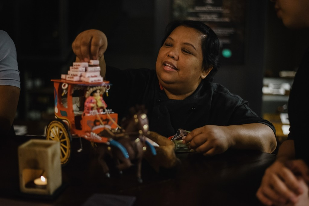 Ate Cristy of Pepita's Kitchen piling on the chocnut on the jeepney