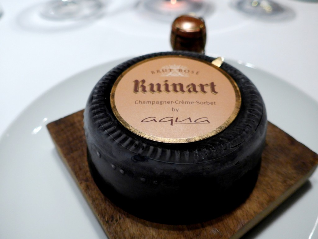 """As soon as this dish was presented to me, I was like """"What is this sorcery?!"""" Ruinart rose is one of my favorite champagnes 🍾🍾🍾, and Sven Elverfeld has transformed it into the creamiest sorbet in the world (it's so freaking good, aaaah!!!😍😍😍) served in.. the base of the Ruinart champagne bottle!😎😎😎 (Swipe left 3x to see!). It's become Aqua's signature dish since then and with excellent reason!"""