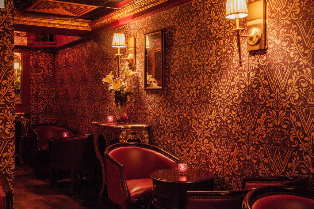 The Wise King is reminiscent of an old world salon. If you look closely at the wallpaper, you'll notice a prominent W with a crown on top. (Photo courtesy of The Wise King)
