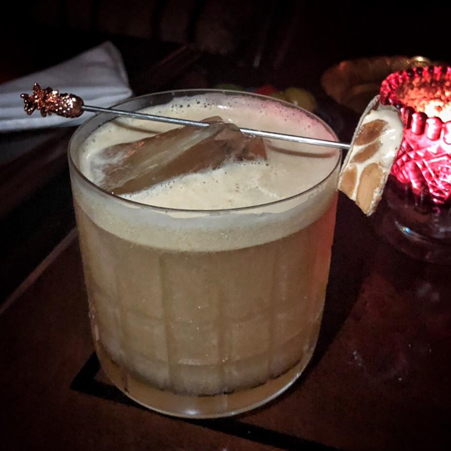 he Turron Sour, inspired by the nougat confection of the same name, with Woodford bourbon, roasted nuts, honey syrup and PX thick foam. (Photo by Cheryl Tiu)
